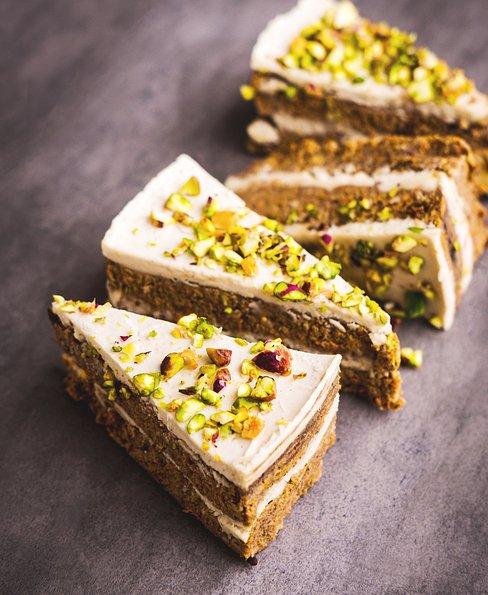 Raw vegan pistachio carrot cake with fluffy cashew cream