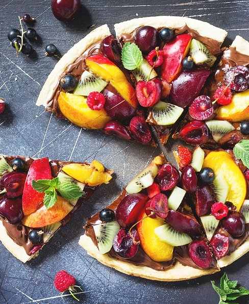 Summer fruit berry pizza with chocolate paste