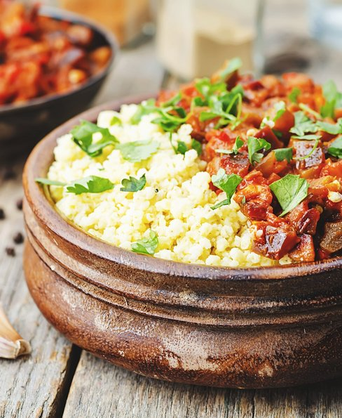 Tomato and eggplant curry with buttered millet